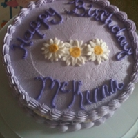 Purple & Daisy B-Day Cake made for a little girl. Daisys are fondant, rest of the cake is b/c