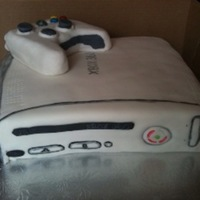 X Box Cake for a 16 yr old boy b-day party. Controller is RKT's covered in fondant. The buttons are skittles & mm's. Cake is vanilla...