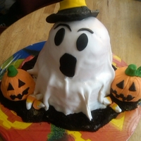 Happy Halloween Ghost cake I made for a Halloween party this past Saturday. Yellow cake and devils food cake with cookies and cream filling. Two eight inch...