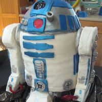 R2D2 Birthday Cake 3D  This is my first cake with fondant. My 9 year old son had a Star Wars Birthday Party. My kids made all of the gadgets out of fondant and...