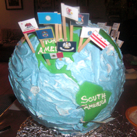 Globe 3D Cake  I made this cake for teacher appreciation. the flags were from all the teachers countries. the frosting is butter cream and the continents...