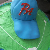 Baseball Hat   My sons baseball team had a end of the year party. the had is fondant and rice crispies for under the bill.