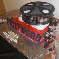 "Hollywood Film Made this for a fundraiser. The ""film"" on the reel is rolled out tootsie rolls. I had pictures of the fundraisers printed on rice..."