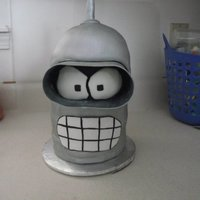 Bender From Futurama yellow cake w/ chocolate buttercream. Covered in fondant. Gumpaste for the goggles and antenna...thanks for looking!