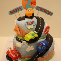 Cars And Trucks Birthday Cake Chocolate MMF covered 2-tier cake, gumpaste/fondant lettering and fondant accents. Inspired by cakes here on CC