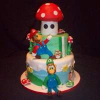 Mario Birthday Figures made from fondant/gumpaste mixture. Mushroom is RK treat covered in fondant.