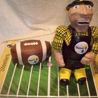 Steely Mcbeam Steelers mascot, Steely McBeam - carved body from cake, head and arms are RK treats covered in fondant. Board is not cake.