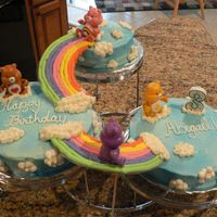 "Care Bear Birthday Cake Daughter's 3rd birthday cake. 6"" and 2 - 8"" rounds on Wilton cake stand. Decorated in BC and then with Wilton blue color..."