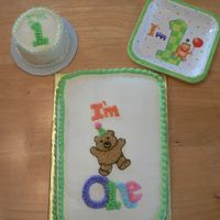 "First Birthday Bear Cake Daughter's 1st birthday cake and smash cake. Cake made to match plates and birthday hat. Smash cake is 4"" round. Big cake is 9x13..."