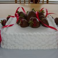 My Husband's Birthday Cake First attempt at basket weave. Buttercream icing on a square cake with chocolate dipped strawberries.