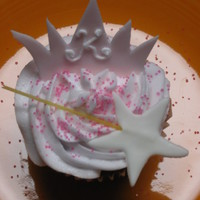 "Princess Cupcakes  Chocolate cupcake topped with pink buttercream frosting, an MMF tiara lettered with a ""K"", and a MMF star (spaghetti noodle as..."
