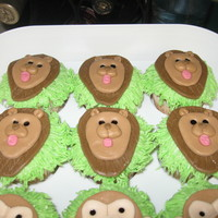 King Of The Jungle Baby Shower Cupcakes   Lion and monkey head cupcakes made with MMF.