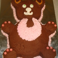 Teddy Bear Girl Baby Shower Cake   Covered in chocolate buttercream. Make with multiple size cake pans.