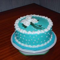 Teal Blue   this was a practice cake that i have to do next week for a 62 year old woman, needless to say we ate cake all week. peace