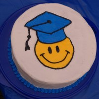 Smiley Face Graduation Cake Made for my daughter's 5th grade graduation party. School colors are yellow and blue.