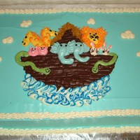 Noah's Ark Cake Made for a co-worker's baby shower. All buttercream. My first major attempt at figure piping. Used bag striping technique to make the...