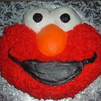Elmo! Elmo character cake, all iced in buttercream, filled with a little vanilla buttercream and sliced fresh strawberries, french vanilla cake...