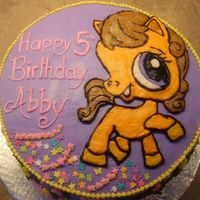 "Littlest Pet Shop 10"" 4 layer french vanilla cake with 3 layers of chocolate mousse. FBCT of the pony character, all iced in buttercream."