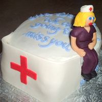 "Nurse's Cap Cake Shaped to look like a nurse's cap done in gumpaste/fondant is leaning against a 8"" chocolate banana cake filled with vanilla..."