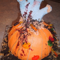 Zombie Hand My first attempt at a rice crispy treat figure, that is what I made the hand out of and covered it in fondant. The cake was carved from 2...