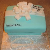 Tiffany Gift Box French vanilla cake filled with chocolate ganache made to look like a Tiffany gift box. Home-made fondant covers the cake along with...
