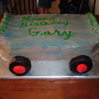 Grandsons Birthday Cake This is my grandson's birthday skateboard cake. It is an oreo cake that I tried to shape into a skateboard.