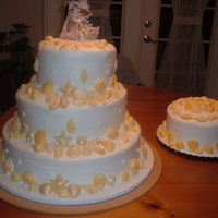Seashell Wedding Cake Yellow cake with buttercream frosting. Seashells are all candy.