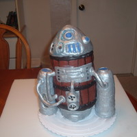 Steampunk R2D2 Eight layers of yellow butter cake with buttercream frosting covered in chocopan fondant.Legs are made with rice krispy treats covered in...