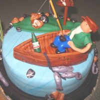 Fisherman This is my 6th fondant cake. Lemon cake with lemon curd filling. non edible items: fishing rod, catails and stems, sign post pole. This was...