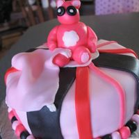 Baby Girl Bear This is my second fondant cake.I had made this for my cousins babyshower. I believe I did pretty good..