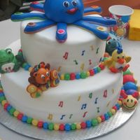 Baby Einstein I made this cake for my friends son. It was his 1st birthday. everything you see is edible. made with MMF .cake flavor is a chocolate...