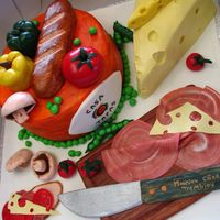 Casa Tapas Cake This cake was made for my brothers friend. He is a chef at the Casa Tapas restaurant. It was a huge hit..hehe! All is edible made with MMF...