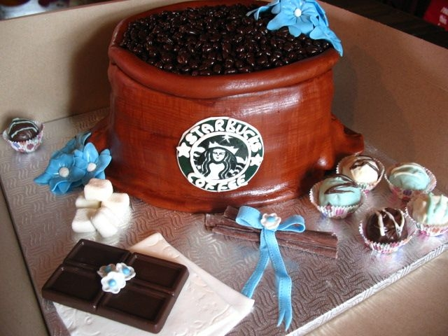 Starbucks Coffee Cake This cake was made for a bridal shower. Everything is edible. Cakepop truffles, fondant napkin, flowers, coffee beans, cinnamon sticks and...