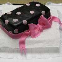 Polka Bow I made this cake for my mommy group..some one bought it on the way however..hehe..this was also a first time on making a fondant bow.