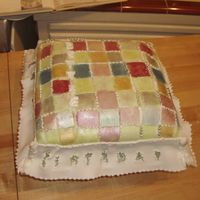 Quilted Pillow Cake Southern style coconut cake with Coconut flavored buttercream frosting. Covered in coconut flavored fondant and hand painted with luster...
