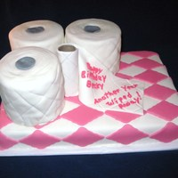 "Another Year Wiped Away/pink   white cake, bc covered with mmf, t-tissue rolls made with 6"" pan, covered with mmf"