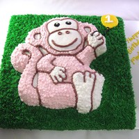 Pink Monkey   White almond, wilton monkey pan on top of sheet cake. bc icing