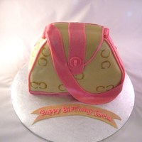 Small Coach Purse   white cake, bc covered in mmf, C's painted on