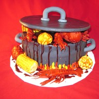 Crawfish Boil 3   choc fudge cake, choc icing covered in mmf, corn and potatoes made with rct covered in mmf, lemons and crawfish made of mmf