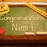 Congratulations I made this cake for a friend who is getting an award for teaching. It was a rush job, but I am pretty happy with it. It is iced in...