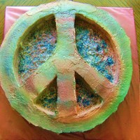 Peace This is a 16in round cake double layered with the top layer carved out. It is white cake frosted with BC and air brushed with color with...