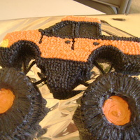 Monster Truck We made this monster truck for a little boy b-day. The cake is vanilla cake with BC icing.