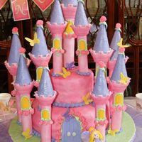 Fairy Castle Cake This is a castle cake I did for my daughter's 6th birthday. I used the Wilton Romantic Castle Set and everything is covered in fondant...