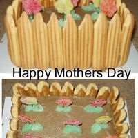 Mothers Day Cake Here is a a picture of a mothers day Cake. It is a Yellow cake made in a loaf pan and then frosted with brown icing and then I put stella...