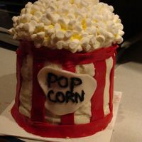Popcorn Cake This is my first stacked cake. This is a popcorn cake made of yellow cake and buttercream frosting. Thanks to all you who have done popcorn...
