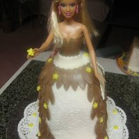 Barbie Cake Carrot cake and cream cheese filing.Decorations are fondant!Thanks for looking!