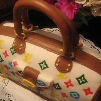 Louis Vuitton Cake Purse   Zest lemon cake and lemon cream filing.My first attempt!!Thanks for looking!