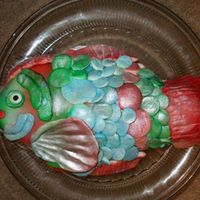 Fish I used a fish-shaped pan to bake it in. The scales and gills are MMF. I colored it using aerosol food spray and pearl dust. The eye is a...