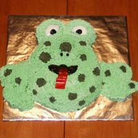 Frog My friend collects frogs so this was her birthday cake. As I was assembling it, I realized my nephews had eaten one set of the cookie legs...