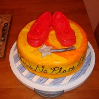 Wizard Of Oz Cake I made this cake for a friend's wife's birthday. I made the ruby slippers out of gumpaste and covered them in fondant. I also...